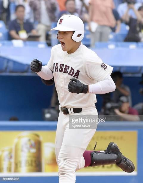 Waseda Jitsugyo High School's Kotaro Kiyomiya rounds the bases after tying the unofficial high school career home run record at Jingu Stadium in...