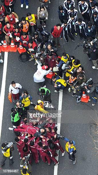 Waseda University Ekiden team head coach Yasuyuki Watanabe is thrown into the air after winning the 87th Hakone Ekiden on January 3 2011 in Tokyo...