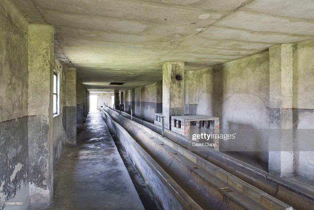 Wash basins in wash house at Birkenau, Auschwitz Concentration Camp in Poland : Stock Photo
