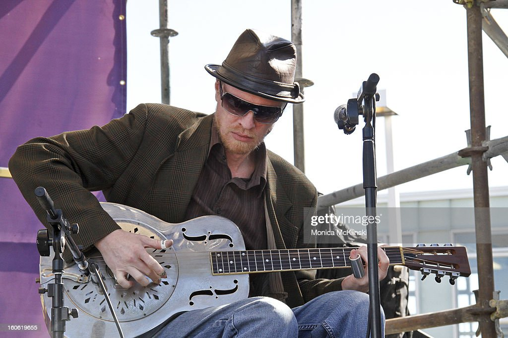 Washboard Chaz Trio guitarist St. Louis Slim performs during the Verizon Super Bowl Boulevard at Woldenberg Park on February 3, 2013 in New Orleans, Louisiana.