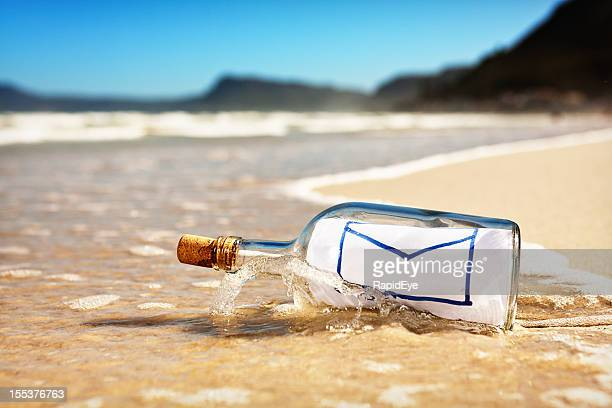 Washed up bottle with message showing icon for email