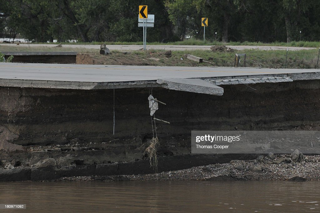 A washed-out road remains impassable to vehicles September 17, 2013 near Evans, Colorado. Even as flooding subsides, many in the hardest hit areas of the state remain stranded by washed out roads and rushing creeks and without water and power.