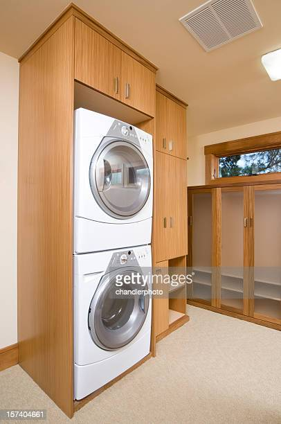 Washer and dryer stacked on each other in a cabinet