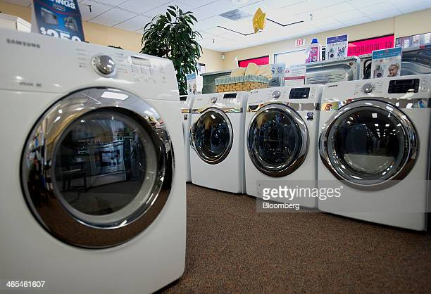 Washers and dryers are displayed for sale in rows at the Jessup's Appliances store in Sarasota Florida US on Friday Jan 24 2014 The US Census Bureau...