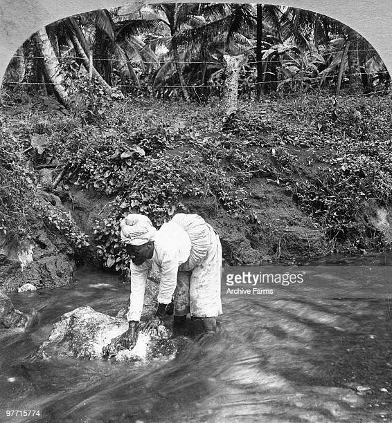 Washing clothes in a stream Jamaica