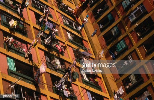 Washing hanging outside windows at high-rise housing estate. : Stock Photo