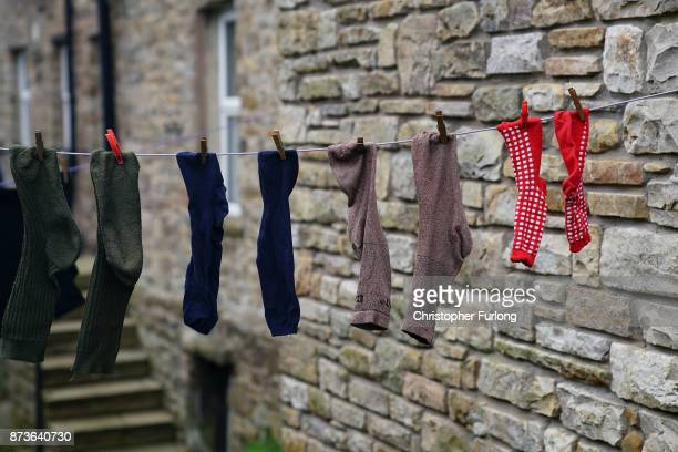 Washing hangs on a line in the Yorkshire village of Hawes which is trying to make itself the most selfsufficient place in Britain on November 13 2017...