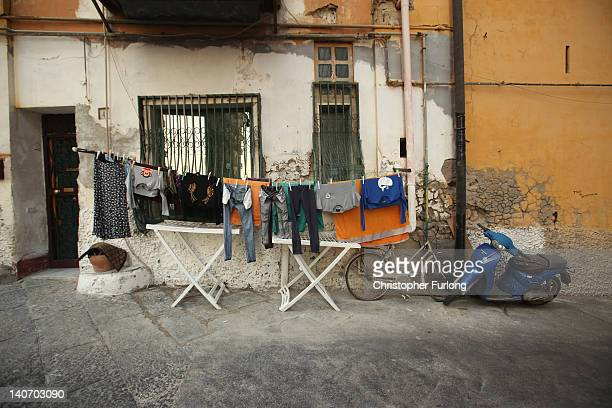 Washing hangs out to dry a familiar view in the narrow streets of Naples on November 17 2011 in Naples Italy Naples is famed for it's narrow streets...