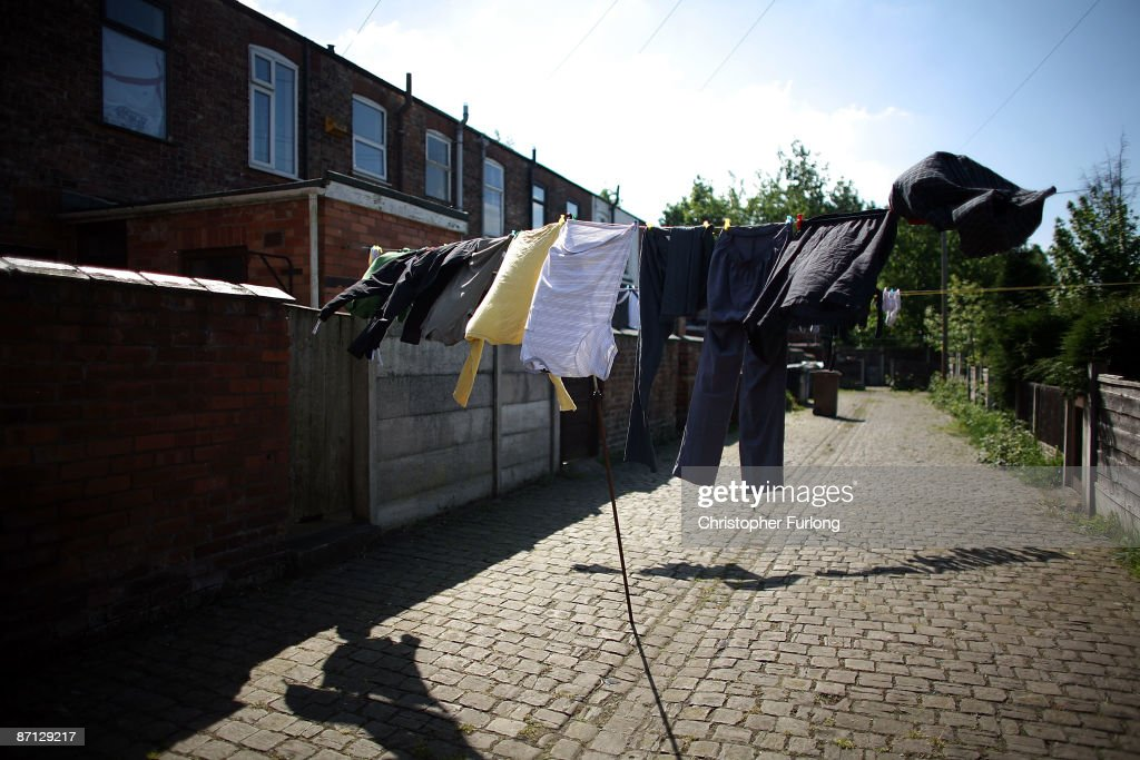 Washing hangs out to dry in the back yard of a home in the Salford constituency of Secretary of State for Communities and Local Government Hazel Blears on May 12, 2009 in Salford, United Kingdom. MP's have come under increasing pressure over revelations concerning their household expenses and second home allowances. Whilst the country at large experiences the effects of a deep recession there is growing unease over MP�s apparent manipulation of a system designed to recompense them for costs incurred in serving their constituents.