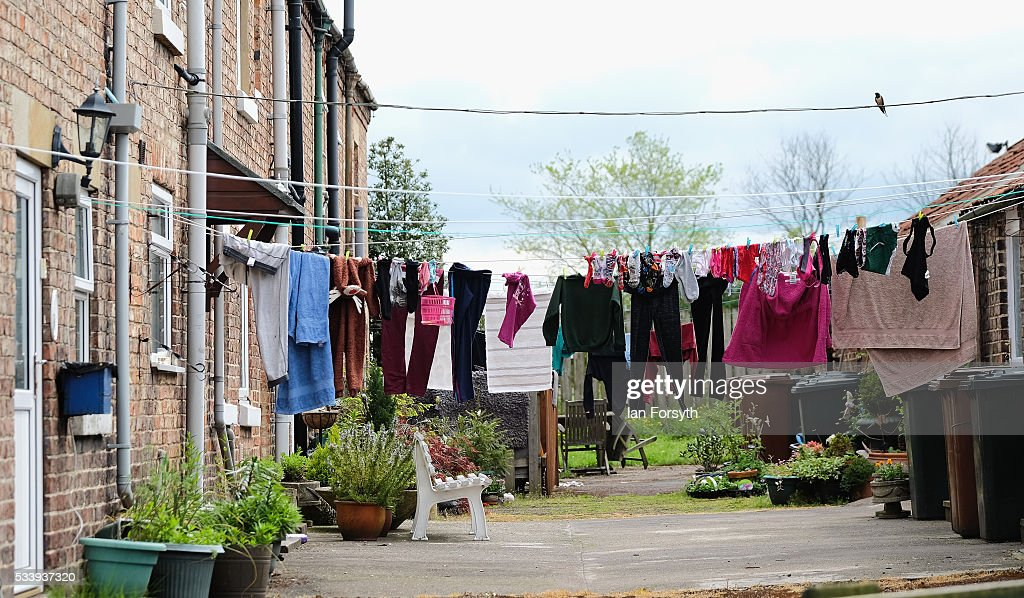 Washing hangs outside homes in the village of Kirby Misperton in North Yorkshire near the site of the KM8 fracking site on May 24, 2016 in Malton, England. North Yorkshire's Planning and Regulatory Committee voted seven to four in favour of a planning application submitted by Third Energy to carry out fracking at the KM8 site. Hydraulic fracturing, or fracking, is a technique designed to recover gas and oil from shale rock. Photo by Ian Forsyth/Getty Images)