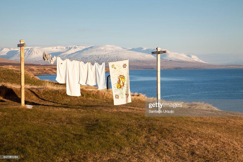 Washing line with Skagafjordur fjord on background
