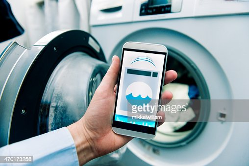 washing machine controlled by app on a smart phone stock photo getty images. Black Bedroom Furniture Sets. Home Design Ideas