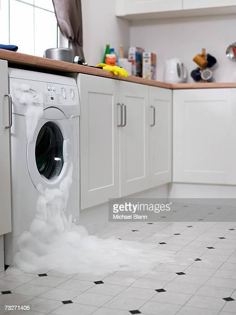 Washing machine overflowing in kitchen