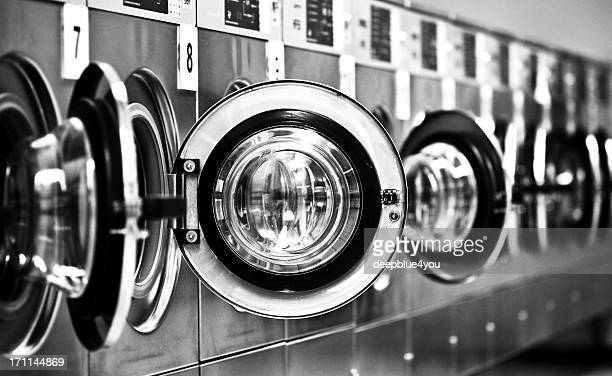 Washing machine row with open doors