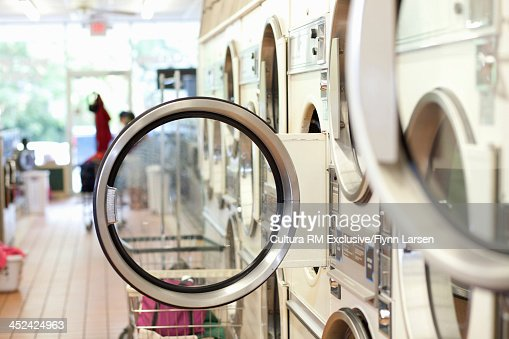 Washing machines with doors open in lauderette
