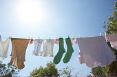 washing on line one pair of green socks