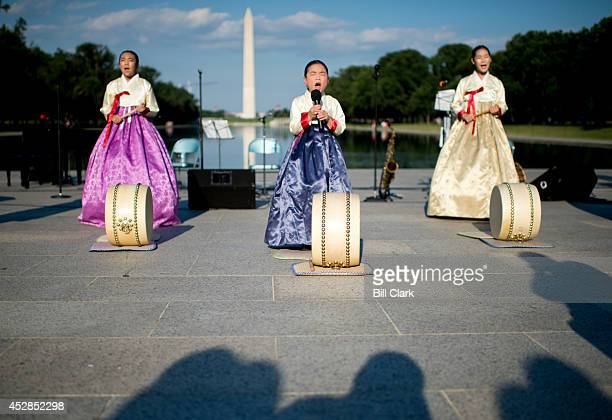 Washinghton Sorichung from the Korean Traditional Music Pansori Institute perform at the reflecting pool during the Remember 727 Korean War Armistice...