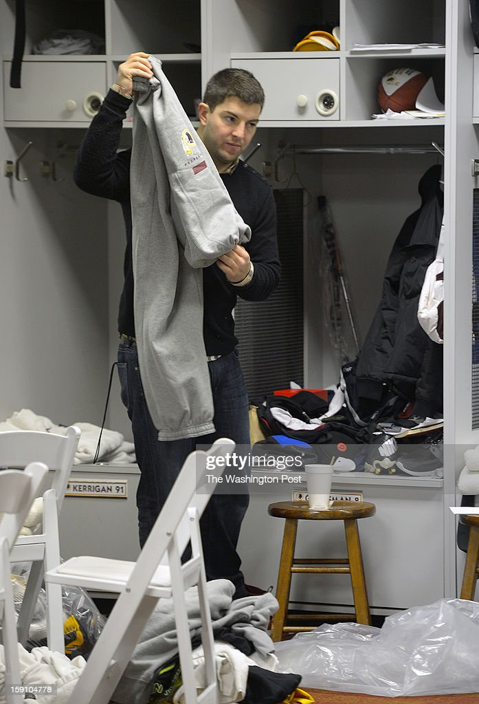 Washington back up quarterback Rex Grossman folds sweat pants as he cleans out his locker at the Redskins practice facility in Ashburn Va. This, after their season ending loss the day before to the Seattle Seahawks in the first round of the NFC playoffs.