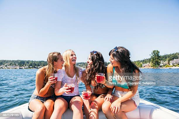 USA, Washington, Bellingham, Young women having fun on motorboat
