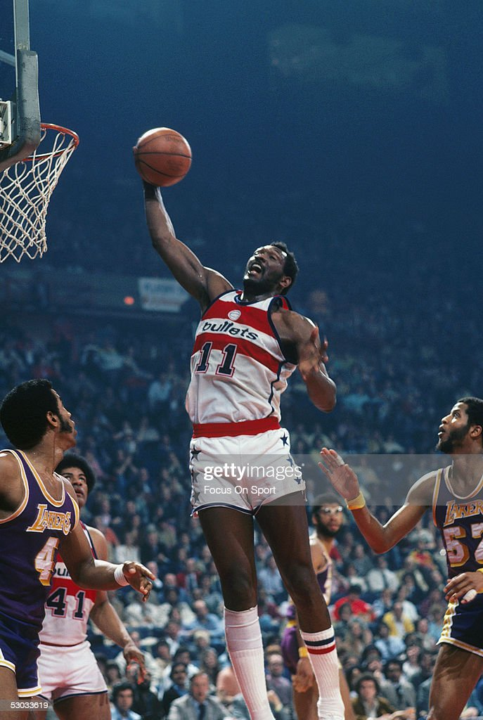 Washington Bullets' forward Elvin Hayes jumps and grabbs the rebound during a game against the Los Angeles Lakers at Capital Centre circa 1978 in...