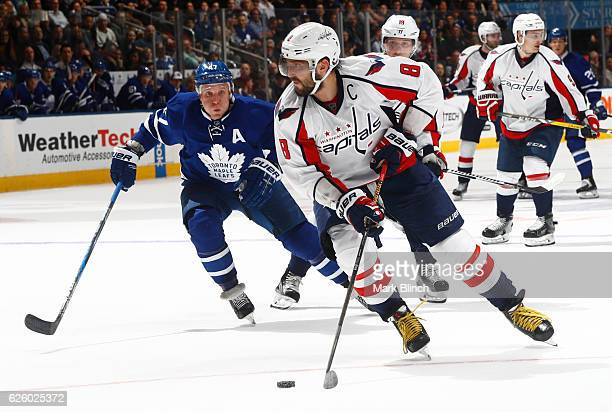 Washington Capitals' Alex Ovechkin is pursued by Toronto Maple Leafs' Leo Komarov during the third period at the Air Canada Centre on November 26...