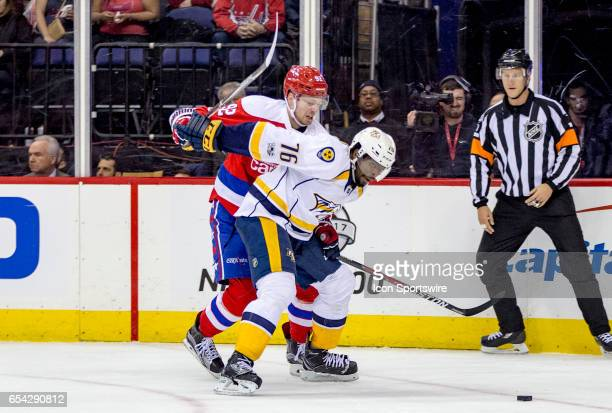 Washington Capitals center Evgeny Kuznetsov and Nashville Predators defenseman PK Subban go after the puck during an NHL game on March 16 at the...
