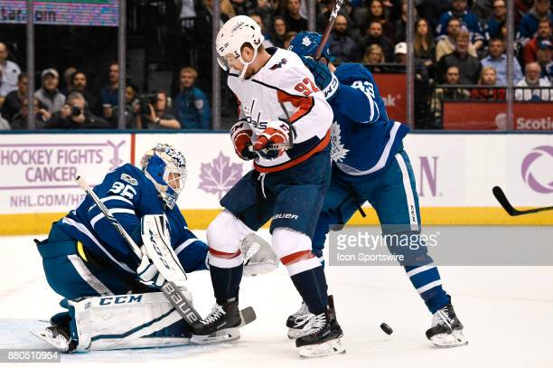 Washington Capitals Center Evgeny Kuznetsov shoots on goal as Toronto Maple Leafs Goalie Curtis McElhinney loses the puck as Toronto Maple Leafs...
