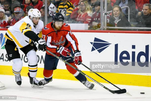 Washington Capitals center Liam O'Brien skate Pittsburgh Penguins defenseman Brian Dumoulin in the first period on November 10 at the Capital One...