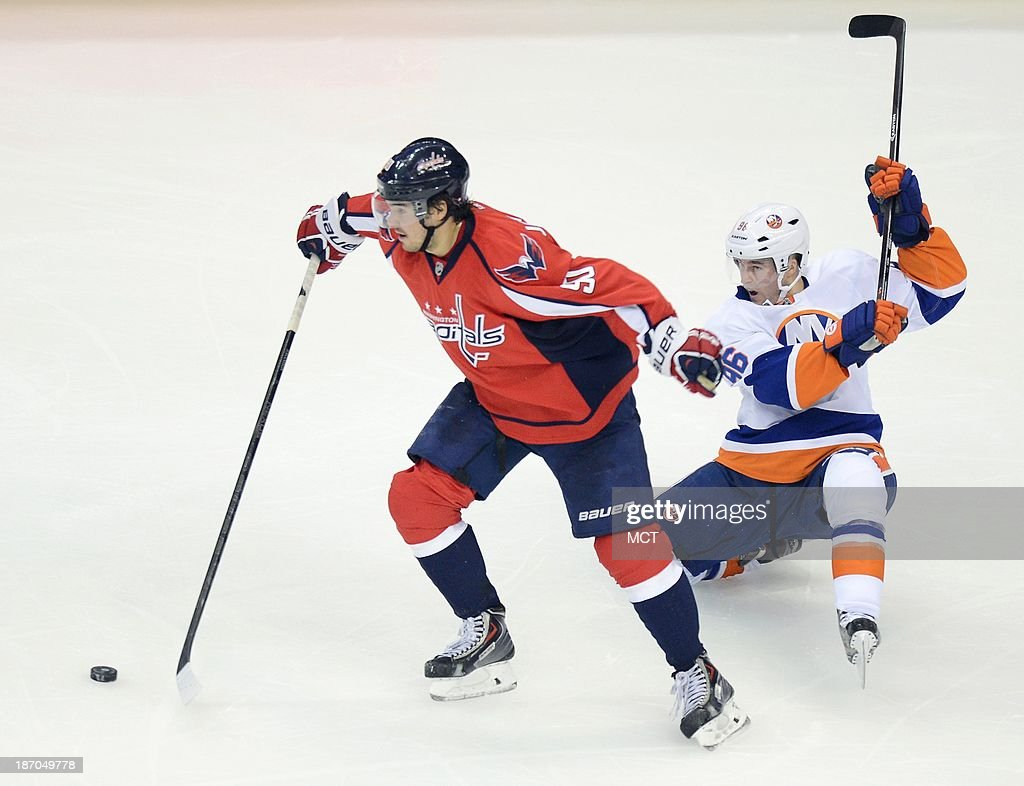Washington Capitals center Marcus Johansson (90) sheds a back check by New York Islanders center Pierre-Marc Bouchard (96), as he maintains control of the puck in the third period at the Verizon Center in Washington, D.C., Tuesday, November 5, 2013. The Capitals defeated the Islanders, 6-2.
