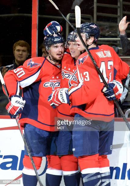 Washington Capitals center Nicklas Backstrom center celebrates with teammates Marcus Johansson and Tom Wilson following his goal against the New York...