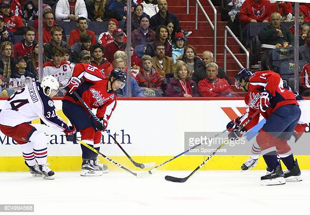WASHINGTON DC NOVEMBER Washington Capitals center Nicklas Backstrom flips the puck over the stick of Columbus Blue Jackets right wing Josh Anderson...