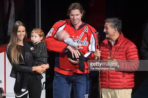 Washington Capitals center Nicklas Backstrom is feted before the game against the Philadelphia Flyers for his career 500 assist in the NLH with his...