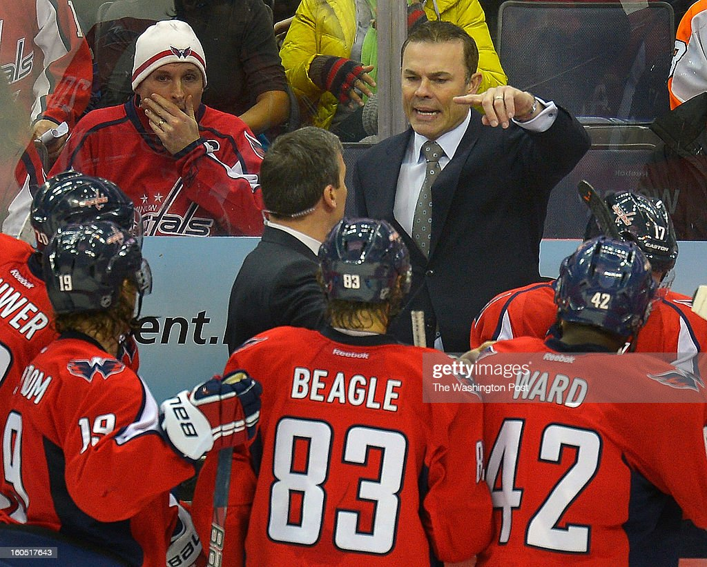 Washington Capitals coach Adam Oates instructs his team during a late time out as the Washington Capitals defeat the Philadelphia Flyers 3 - 2 at the Verizon Center in Washington DC, February 1, 2012 .