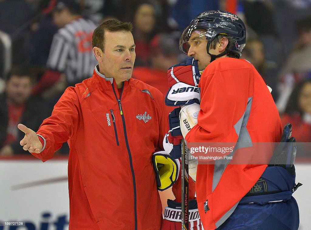 Washington Capitals' coach Adam Oates, left, converses with star Alex Ovechkin during a fan appreciation night which the fans watched an on ice practice at the Verizon Center in Washington DC, January 17, 2012 .