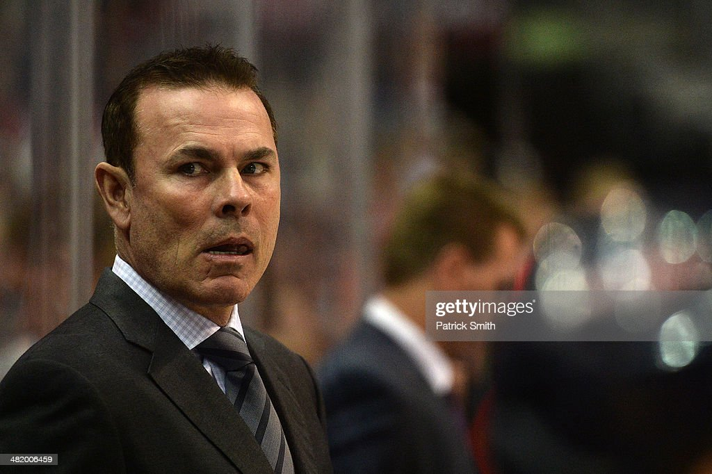 Washington Capitals coach Adam Oates looks on against the Dallas Stars during an NHL game at Verizon Center on April 1 2014 in Washington DC The...