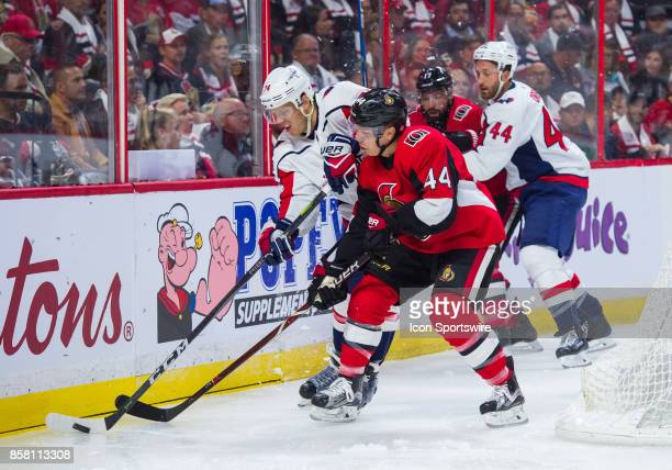 Washington Capitals Defenceman John Carlson stickhandles the puck against Ottawa Senators Center JeanGabriel Pageau during the NHL game between the...