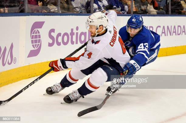 Washington Capitals Defenceman Taylor Chorney is pursued closely by Toronto Maple Leafs Center Nazem Kadri during the NHL regular season hockey game...