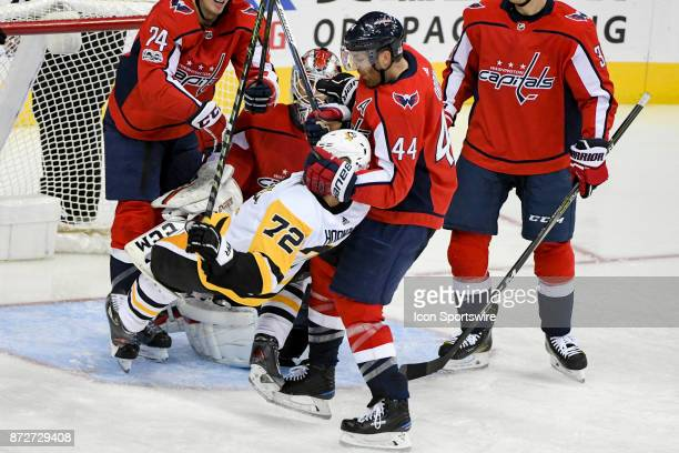 Washington Capitals defenseman Brooks Orpik drags Pittsburgh Penguins right wing Patric Hornqvist to the ice in the third period on November 10 at...