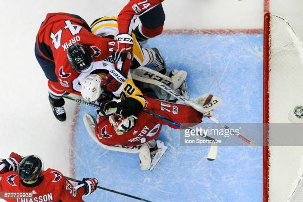 Washington Capitals defenseman Brooks Orpik wraps up Pittsburgh Penguins right wing Patric Hornqvist in the crease in front of goalie Braden Holtby...
