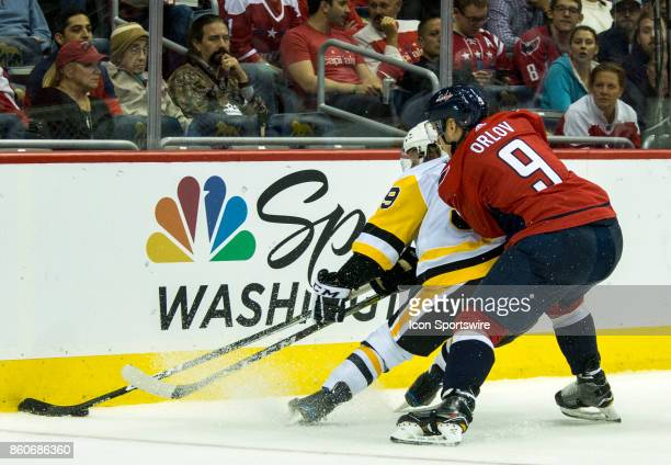 Washington Capitals defenseman Dmitry Orlov checks Pittsburgh Penguins center Jake Guentzel during a NHL game between the Washington Capitals and the...