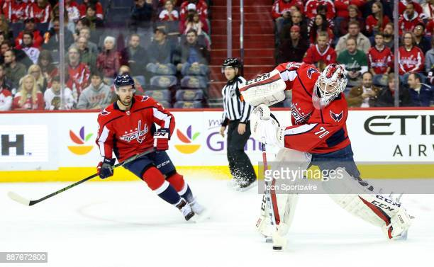 Washington Capitals defenseman Matt Niskanen watches as goalie Braden Holtby leaves the goal to clear up ice during a NHL game between the Washington...