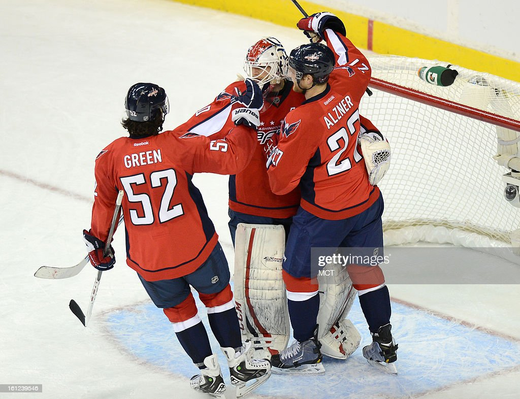 Washington Capitals defenseman Mike Green (52) and defenseman Karl Alzner (27) congratulate goalie Braden Holtby (70) following a 5-0 victory over the Florida Panthers at the Verizon Center in Washington, D.C., Saturday, February 9, 2013.