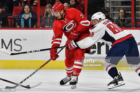Washington Capitals defenseman Nate Schmidt defends against Carolina Hurricanes defenseman Matt Tennyson in a regular season NHL game between the...