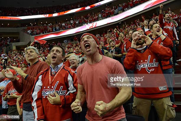 Washington Capitals fan Aaron Book of Washington DC center joins other fans in cheering during the second period of the Eastern Conference Semi Final...