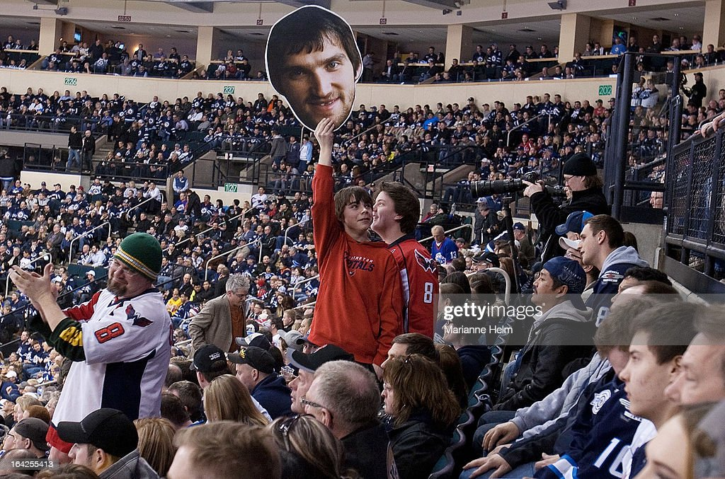 A Washington Capitals fan holds up a cutout of captain Alex Ovechkin during third-period action against the Winnipeg Jets on March 21, 2013 at the MTS Centre in Winnipeg, Manitoba, Canada.