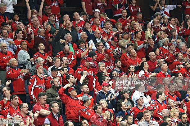 Washington Capitals fans cheer as they play the Philadelphia Flyers during the third period in Game One of the Eastern Conference Quarterfinals...
