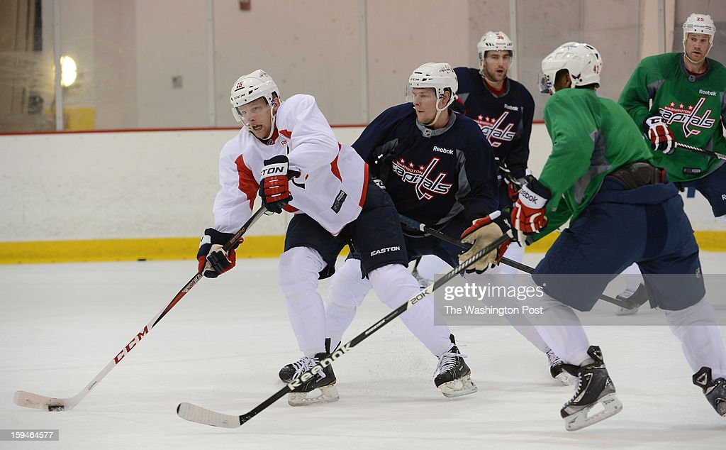 Washington Capitals forward Joey Crabb, left, skates with the puck during the Washington Capitals' first official practice of the season on Sunday, January 13, 2013.
