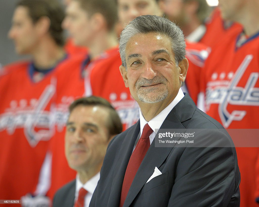 Washington Capitals' General Manager George McPhee, left, and owner Ted Leonsis prepare to sit with their team at the annual Washington Capitals team photo shoot at the Kettler Capitals Iceplex in Arlington VA, March 27, 2014.