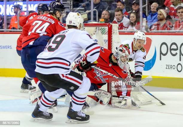 Washington Capitals goalie Braden Holtby beats Chicago Blackhawks right wing Richard Panik to the puck during a NHL game between the Washington...