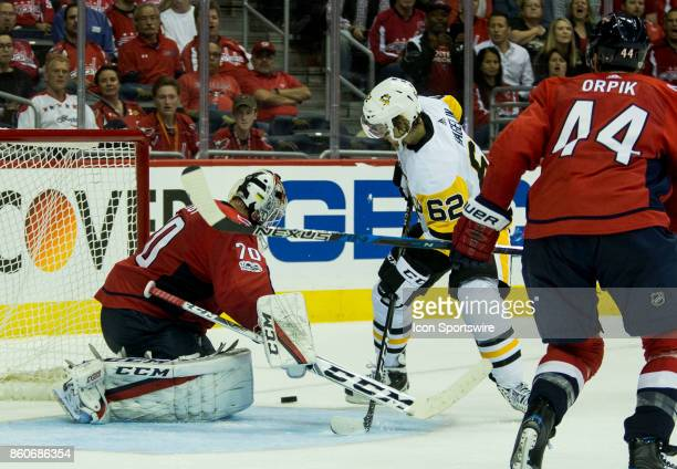 Washington Capitals goalie Braden Holtby blocks a shot from Pittsburgh Penguins left wing Carl Hagelin during a NHL game between the Washington...